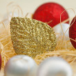 Stock Photo: Christmas card with balls and gold leaf