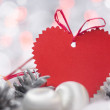 Christmas card with heart, balls, pines and bokeh — Stock Photo