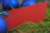 Christmas card with balls spruce twig — Stock Photo