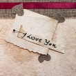 Royalty-Free Stock Photo: Art greeting card on vintage background (heart, old paper, fabri