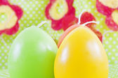 Art Easter greeting card with candles as eggs — Stock Photo