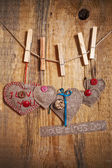 Decoration on Wooden background with fabric Hearts and words Val — Stock Photo