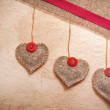 Stock Photo: Art vintage background with fabric Hearts for design