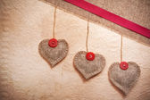 Art vintage background with fabric Hearts for design — Stock Photo
