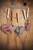 Ozdoba na drewniane tła z tkaniny serca i słowa val — Zdjęcie stockowe