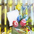 Art easter background with fence, eggs, spring flowers, blank ca — Stock Photo