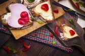 Breakfast hearts sandwiches boards food — Stock Photo