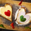 Heart sandwich shape wood board peppers food — Stock Photo #20381403