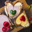 Heart sandwich shape wood board peppers food — Stock Photo