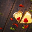 Heart sandwich shape wood board peppers food — Stock Photo #20381933