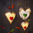 Heart sandwich shape wood board peppers food — Stock Photo #20407685