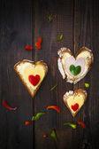 Heart sandwich shape wood board peppers food — Stock Photo