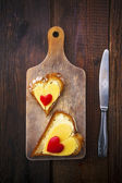 Heart sandwich shape wood board peppers food knife — Stock Photo