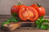 Art vegetable tomato board table wooden parsley fresh — Stock Photo
