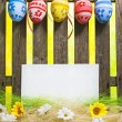 Foto Stock: Art Easter Egg background fence card blank spring flower eggs