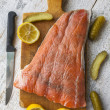 Fish salmon raw slice cutting board eating food - Stock Photo