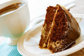 Pastel de cacao postre brownie dulce una taza de café — Foto de Stock