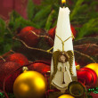 Stock Photo: Christmas card candle light angel ball burning red