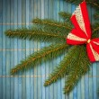 Christmas card with bow on spruce twig — Photo #32152245