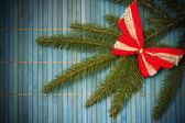 Christmas card with bow on spruce twig — Stok fotoğraf