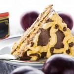 Slice sweat cake cream wooden table board white plum plums — Stock Photo