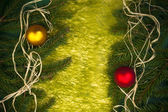 Baubles Glass Christmas card spruce twig green background — Stock Photo