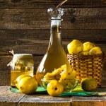 Alcohol quince liqueur sliced fruit prepare wooden setting — Stock Photo #34409059