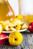 Alcohol quince liqueur sliced fruit prepare wooden setting — Stock Photo