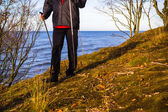Nordic walking sport run walk outdoor person sea figure beach — Stock Photo