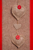 Valentine background hand-sewn hearts texstile — Stock Photo