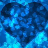 Blue background blurred lights heart — Stock Photo