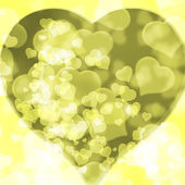 Yellow background blurred lights heart — Zdjęcie stockowe