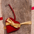 Stock Photo: Valentine background hand-sewn heart texstile