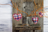 Three hearts hanging branches can — Stock Photo