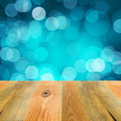 Blue bokeh background wooden table — Foto Stock