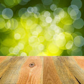 Green bokeh background wooden table — Stock Photo