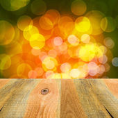 Green orange yellow bokeh background wooden table — Stockfoto