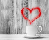 Mug lovers white cup heart shaped balloon wooden background — Stock Photo