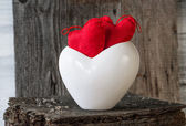 Two Red Hearts twig board white cup — Stock Photo