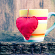 Stock Photo: Heart hung colored cup