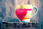 Heart hung colored cup — Stock Photo