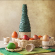 Stock Photo: Still life colorful Easter eggs basket vase