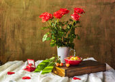 Still life bouquet roses hearts cherries — Stock Photo