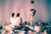 Still life with handmade hearts cups bottle — Stock Photo