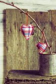 Hearts hanging twig tin box — Stock Photo