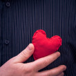 Closeup red heart hand man — Stock Photo #39553831