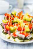 Finger foods toothpicks appetizer — Stock Photo