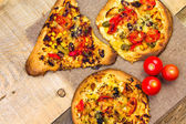 Closeup heavily toasted slices pizza — Stok fotoğraf