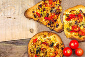 Closeup heavily toasted slices pizza — Photo