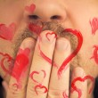 Man love giving away red hearts — Stock Photo #40255199